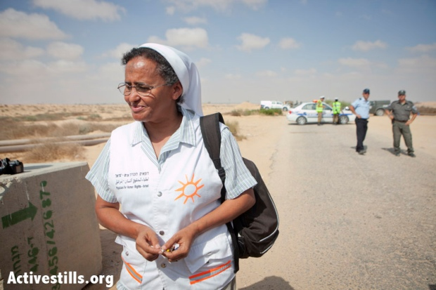 Sister Aziza from Physicians for Human Rights is turned away by the army and police from the zone where African refugees are being held on Israel's southern border, September 6, 2012 (photo: SGActivestills.org)